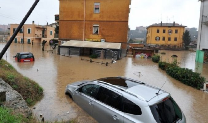 "A picture taken on January 31, 2014 shows cars flooded in ""Prima Porta"", in the outskirts of Rome, after torrential rains hit the region overnight on January 31, 2014. AFP PHOTO / TIZIANA FABI        (Photo credit should read TIZIANA FABI/AFP/Getty Images)"